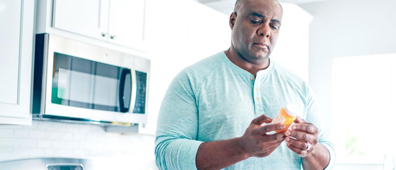 Man looking at his prescription medicine
