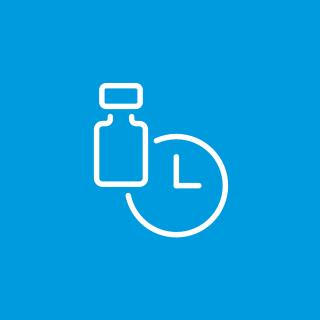 A white icon of a pill bottle and a clock on a blue background.